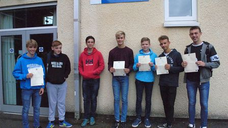 GCSE pupils with their exam results.