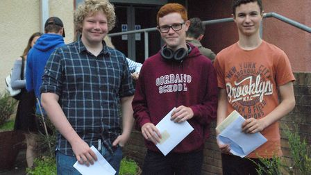 Marcus, Harry and Oliver with their GCSE results.