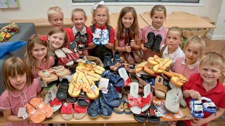 Pupils with some of the shoes they have collected.
