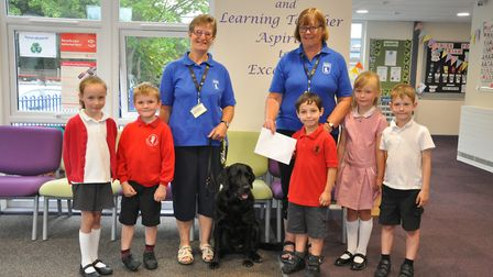 Pupils donated the money they've raised to the Guide Dogs for the Blind Association.