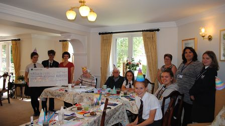 Mary Holbrook and Jeffrey Brown, home owners at St Peter's Lodge in Portishead work with students fr