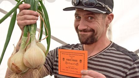 Stephen Lee with his prize winning onions.