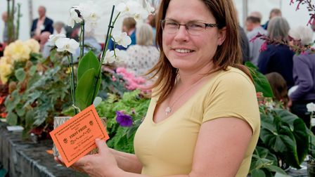 Georgina Heathcote with her prize winning orchid.