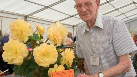 Chairman Bert Filer with a first for his Begonia.