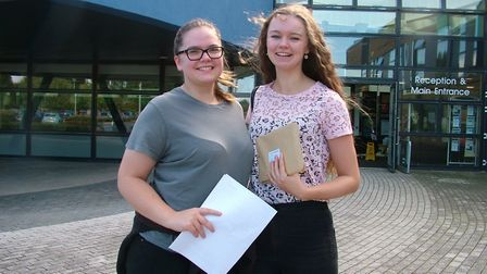 Georgia Greenslade and Elie McBride opening their A-level results at Nailsea School.