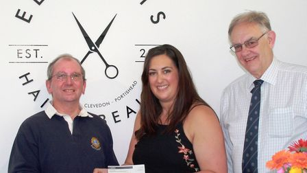 Elements ownr Natalie Charman handing over the £300 cheque to Portishead Lions David Fitzpatrick and