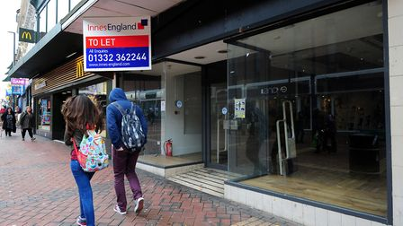 Shoppers walk past an empty unit on the high street. Photograph: Rui Vieira/PA.