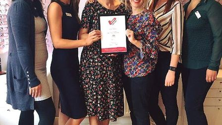 The team at Bowen Opticians with their award.