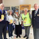 Mayor Jos Holder experiences life without sight in an awareness drive by Weston Lions Club.