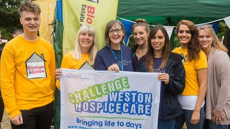 Staff from Bloxham and Barlow estate agents donating money to Weston Hospicecare after completing an