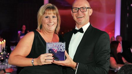 Lindsay Lawrence from C V Gower Funeral Directors receiving the award from Dan Hares of Golden Chart
