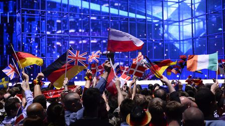 Supporters wave flags ahead of the Eurovision Song Contest (question five) (JONATHAN NACKSTRAND/AFP/
