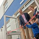 Author Andy Seed cuts the ribbon opening the new classrooms with the help of headteacher Lyn Hunt an