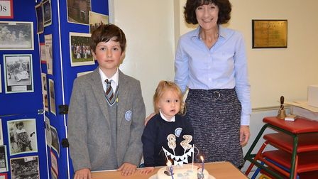 Headmistress Lesley Barton with the youngest and oldest pupil.
