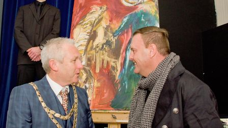 Artist James Richardson unveiling his latest painting, pictured with North Somerset Chairman Cllr Ch