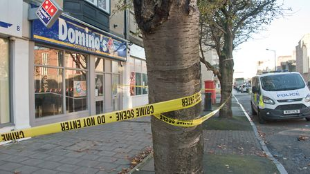 Police taped off the pizza takeaway last week while forensics examined the scene.