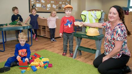 Busy Bees Nursery manager Angie Pass with preschool students in one of the refurbished play areas.