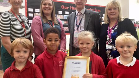 Yeo Moor Primary School pupils and staff with the certificate.