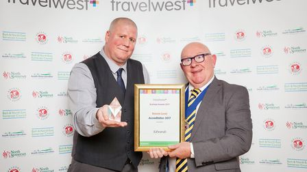 Tony Baker (left) from Edwards being presented with the travel plan accreditation award by Cllr Rob