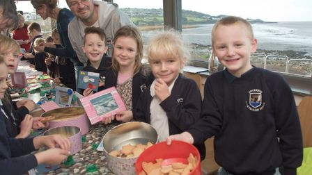 Children selling some of their up-cycled products and seaside biscuits.