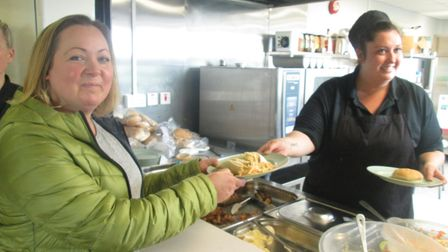 A Tickenham C of E parent being handed a school lunch from chef Charlotte Henley-Smith.