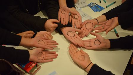 Students taking part in an #iamwhole campaign during mental health awareness day.