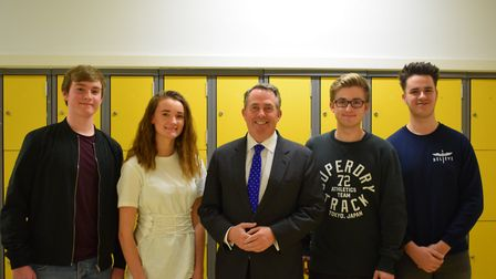MP Dr Liam Fox being given a tour of Nailsea School by school presidents.