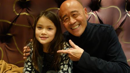 Meili Parkinson with television chef Ken Hom.