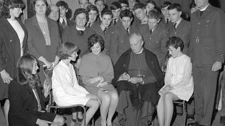 The Bishop of Bath and Wells, Dr. E.B. Henderson, signs autographs for some of the candidates after