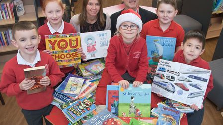 Yeo Moor Primary School headteacher Roland Lovatt and pupils being given 100 books, by Vicky Angear,