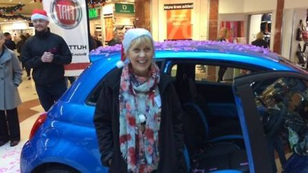 Karen Hughes picked the key to her new Fiat 500s, worth £10,000.