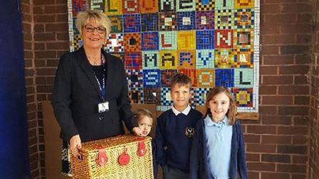 Sue Huxtable presenting pupils with a hamper.