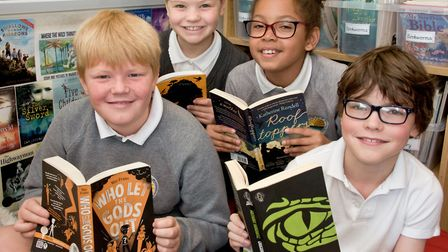 Golden Valley Primary School pupils reading books in their reading area.