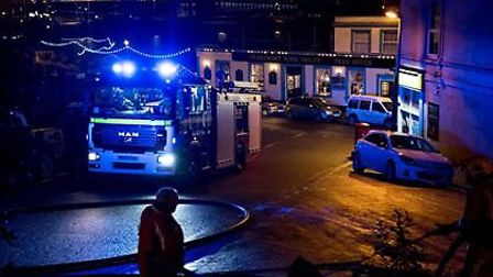 Firefighters in action at the Lynton House Hotel blaze last night.