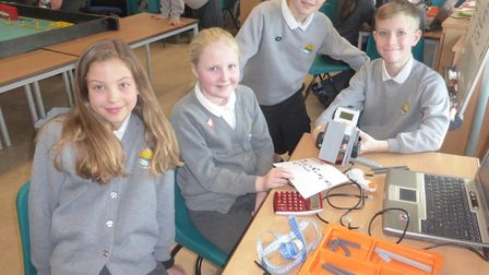 Pupils from Golden Valley Primary School learning to programme their Lego robots.