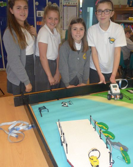 Pupils from Golden Valley Primary School with their Lego robots.