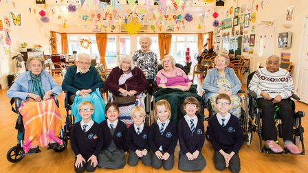 Pupils from Sandford Primary School with residents at St Monica Trust.