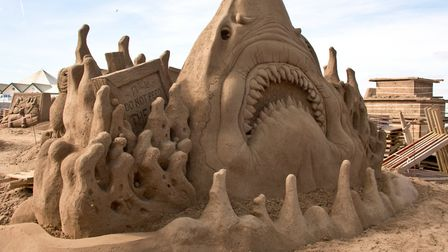 There may be fewer sharks this year, but we may still see some animals made from sand.