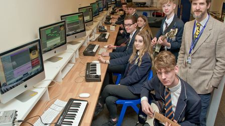 Gordano School students, and teacher Guy Guerrini, creating music with the new equipment.