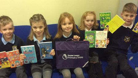Mary Elton Primary School pupils with their poetry books.