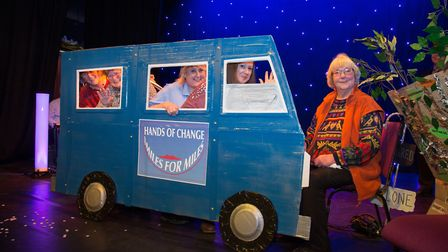 Hands of Change demonstrating their smiles for miles minibus scheme.