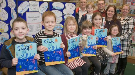 Worelbury Primary School year 2 students promoting a book they have created and published about seal