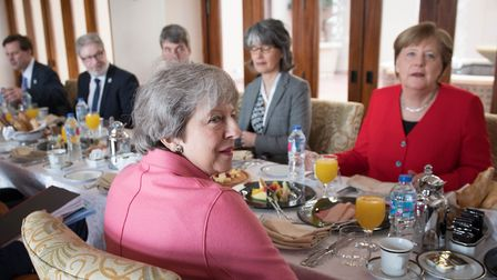 Theresa May (centre) has a breakfast meeting with German Chancellor Angela Merkel (right) at the EU-