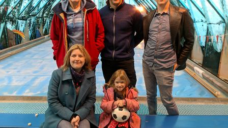 Members of the support group with young swimmer Phoebe. Picture: Peter Stanley