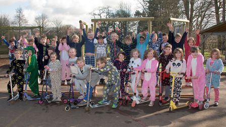 St Francis Primary School pupils on scooters raising money for GWAAC and The Alzheimer's Society.