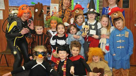 Children dressing up and taking part in extreme reading challenge at West Leign Infant School. Pictu