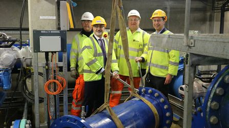 CEO Mel Karam and head of network projects Mike Smith with two Bristol Water workers with the final