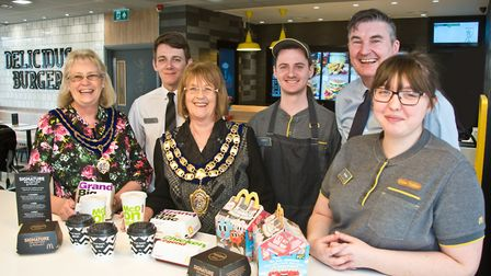 Mayoress Roz Willis and Mayor Jos Holder, with franchisee Tim Lamb and staff members Jordon Perry, L