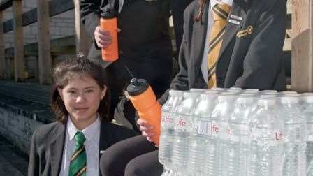 Clevedon School pupils with some of the old plastic bottles which they will be replacing with reusea