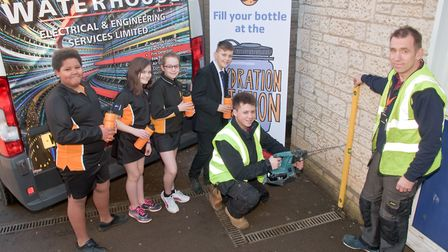 """Clevedon School pupils watching Waterhouse contractors fitting a """"Hydration Station."""""""